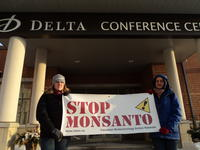 Students greet the President of Monsanto Canada testifying at Agriculture Committee hearings in Guelph