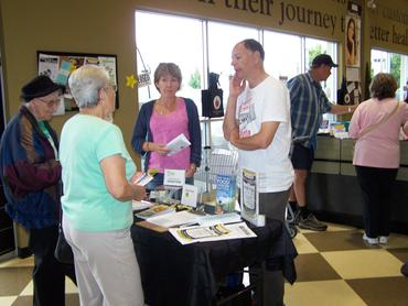 Tony and Margie talk to Nature's Fare shoppers about GM foods, Langley. Sept 22.